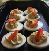 Halved boiled eggs albacore
